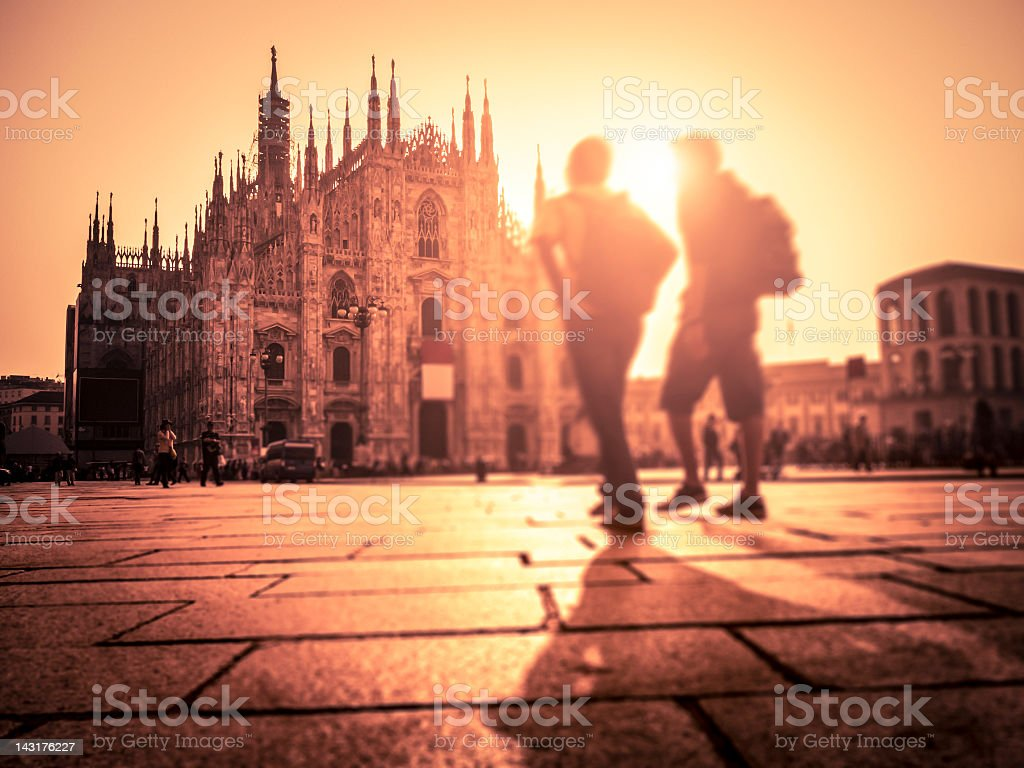 People Walking In Piazza Duomo At Sunset royalty-free stock photo
