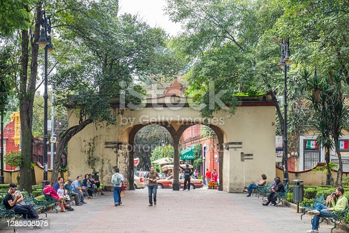 People walking in Plaza Hidalgo at the borough of Coyoacán in Mexico city, Mexico.