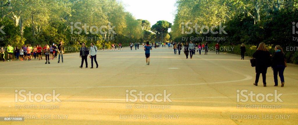 People walking in Retiro Park stock photo