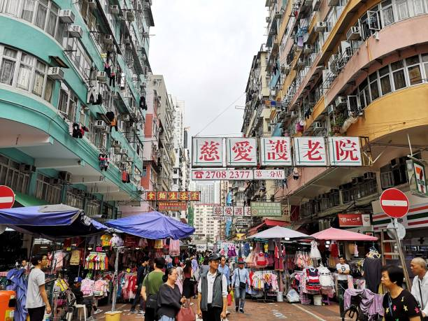 People walking in Sham Shui Po, Kowloon peninsula stock photo