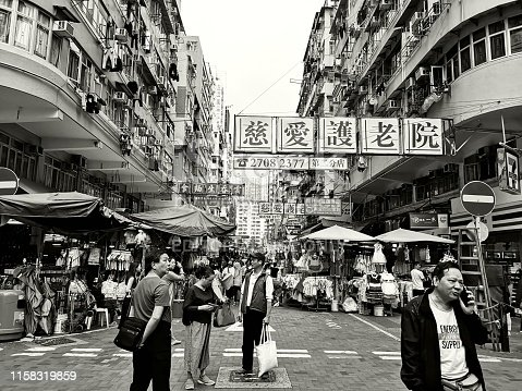 People walking in the busy Sham Shui Po district, Kowloon pensinsula.
