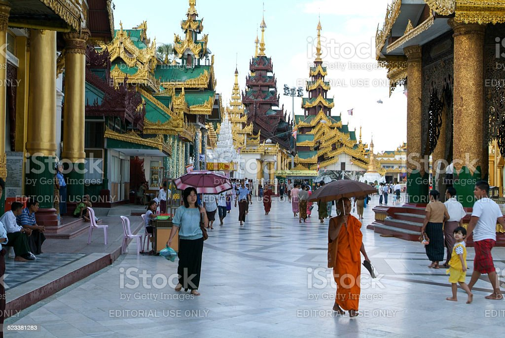 People walking in the area of the Shwedagon Pagoda stock photo