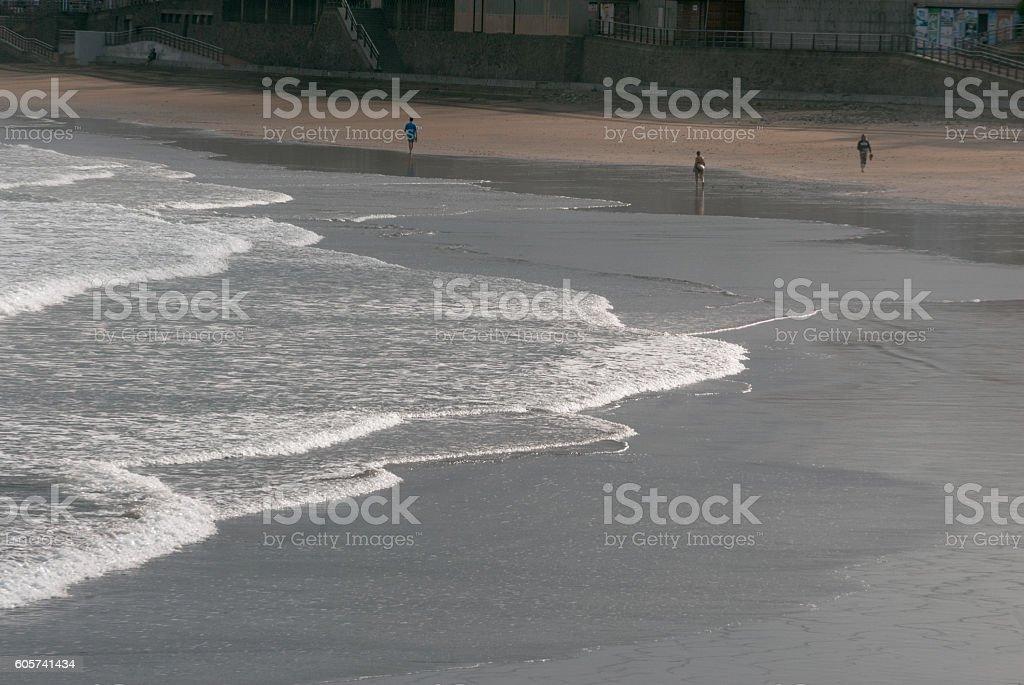 People walking in the beach stock photo