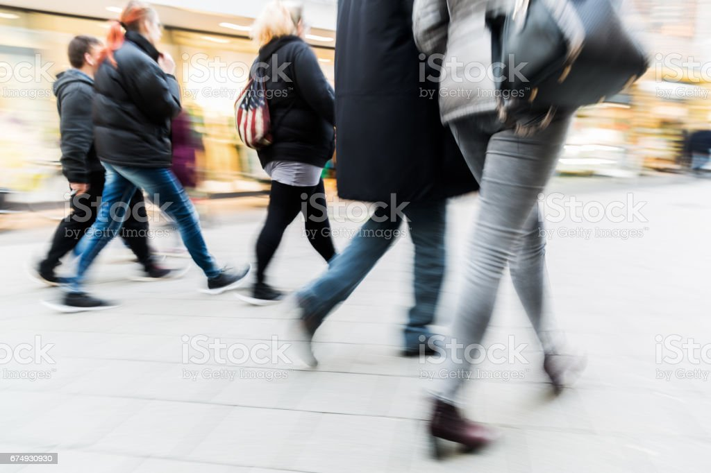 people walking in the city in motion blur royalty-free stock photo