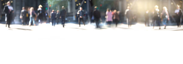 people walking in the city of london. blurred background with spate for text - city walking background foto e immagini stock