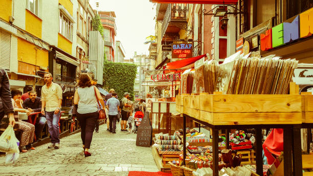 Istanbul, Turkey - June 02, 2017: People walking in the narrow street filled with old shops in Kadikoy, Istanbul. stock photo