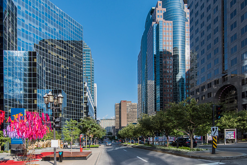 People walking in the street at McGill College avenue in downtown Montreal city, Canada.