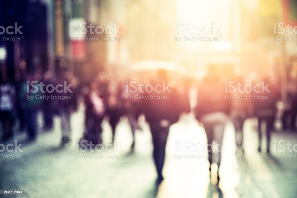 people walking in the street, blurry