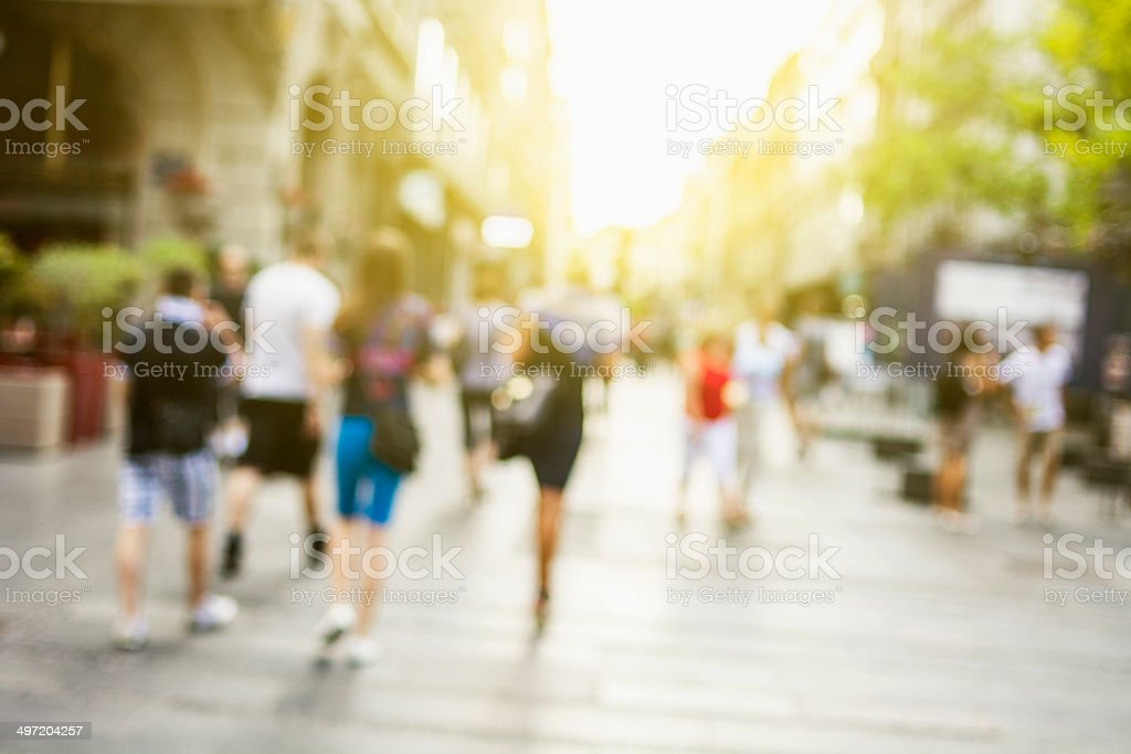 People walking in the street stock photo