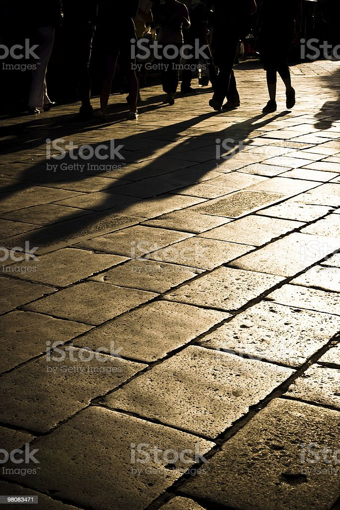 People walking in the sunset royalty-free stock photo