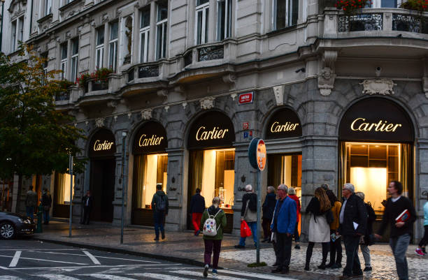 People walking near Boutique Cartier at Parizska street, one of the most popular shopping district in Prague stock photo