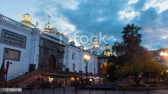 Quito, Pichincha / Ecuador - June 22 2019: People walking near of the Metropolitan Cathedral of Quito at sunset. The historic center was declared by UNESCO the first Cultural Heritage on 1978