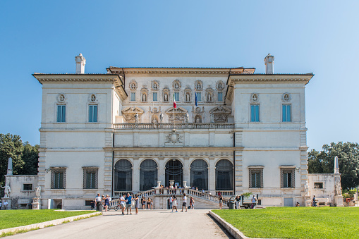People walking next to the Galleria Borghese in Rome city, Italy.