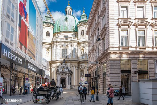 istock People walking next to the St. Peter´s Church in the Graben, a pedestrian street at downtown Vienna, Austria. 1215396445
