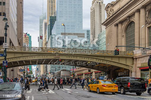 People walking on 42nd Street next to Grand Central Station and Pershing Square bridge at midtown Manhattan, New York City, USA.