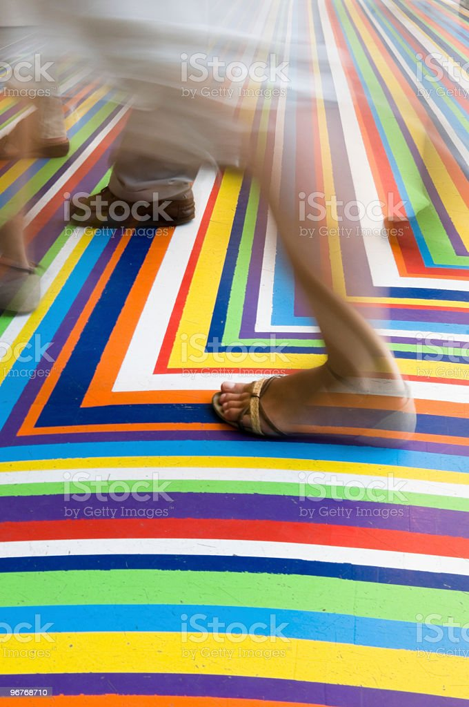 People walking on a coloured floor royalty-free stock photo