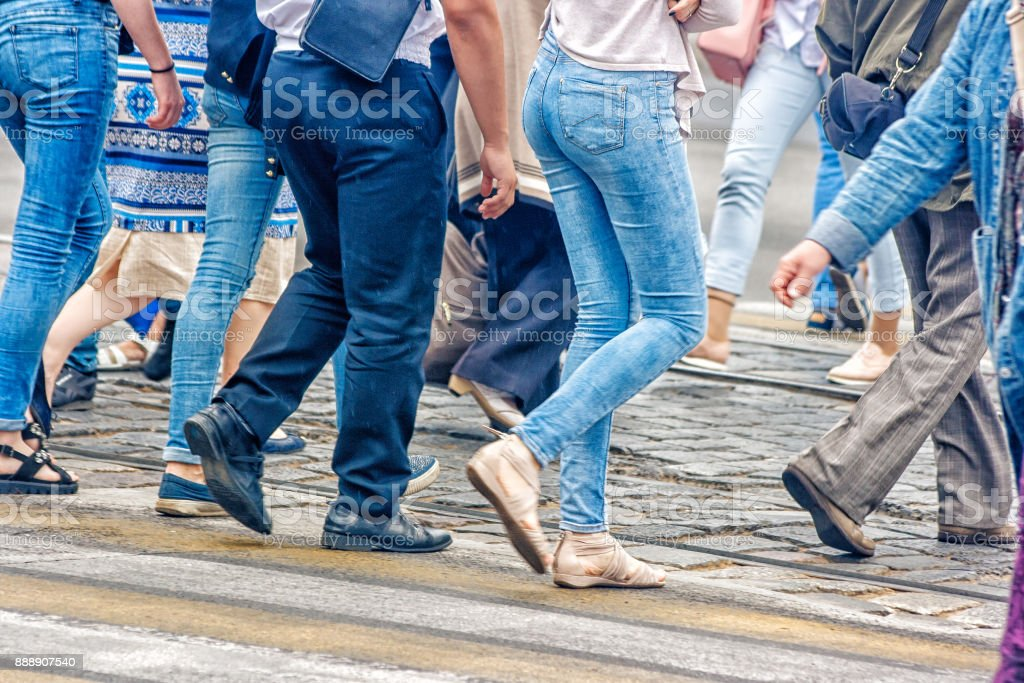 people walking on a pedestrian crossing stock photo