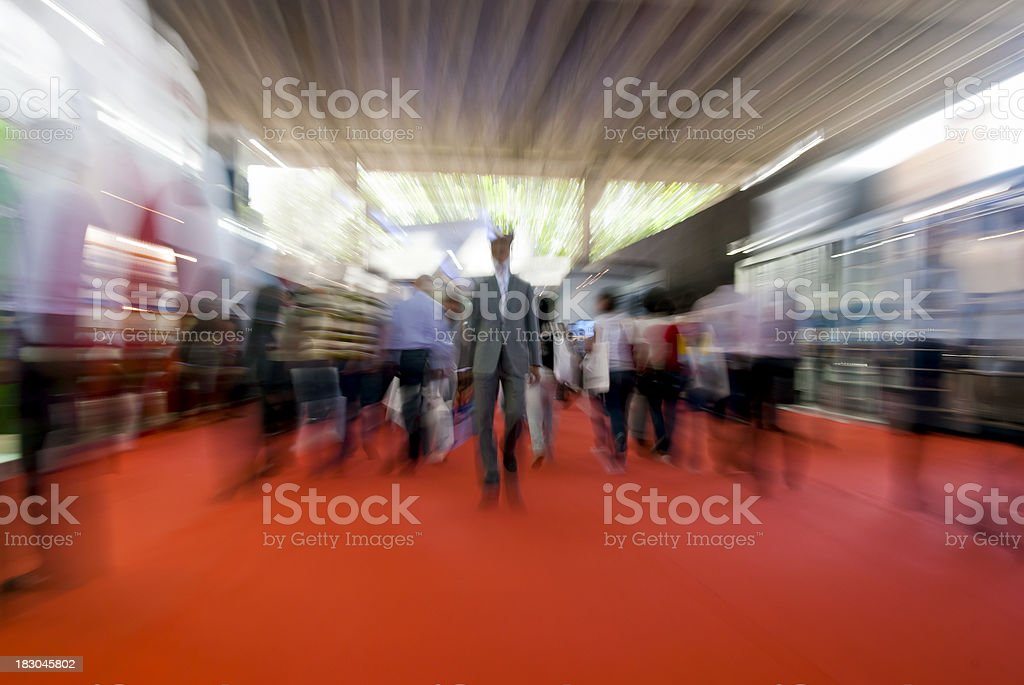 People walking on a red carpet stock photo