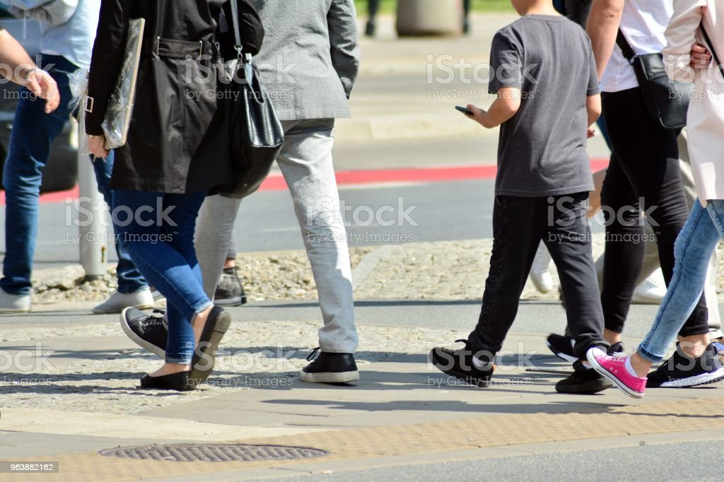 People walking on big city street, blurred motion crossing abstract - Royalty-free Adult Stock Photo