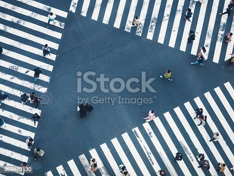 istock People walking on Crossing city street crosswalk top view 969470130