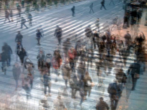 people walking on crosswalk in busy street of Manhattan stock photo