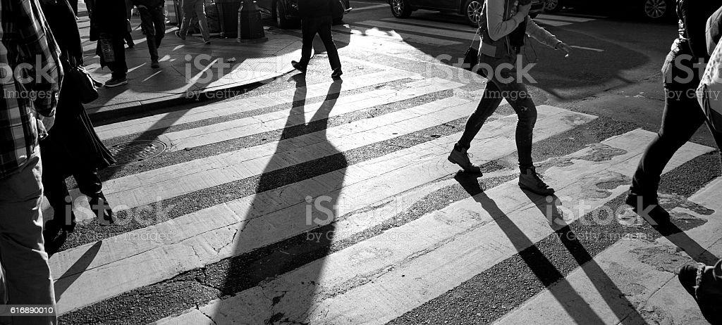 People walking on crosswalk in NYC stock photo