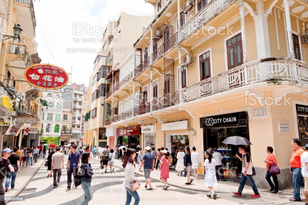 People walking on downtown street in Macau stock photo