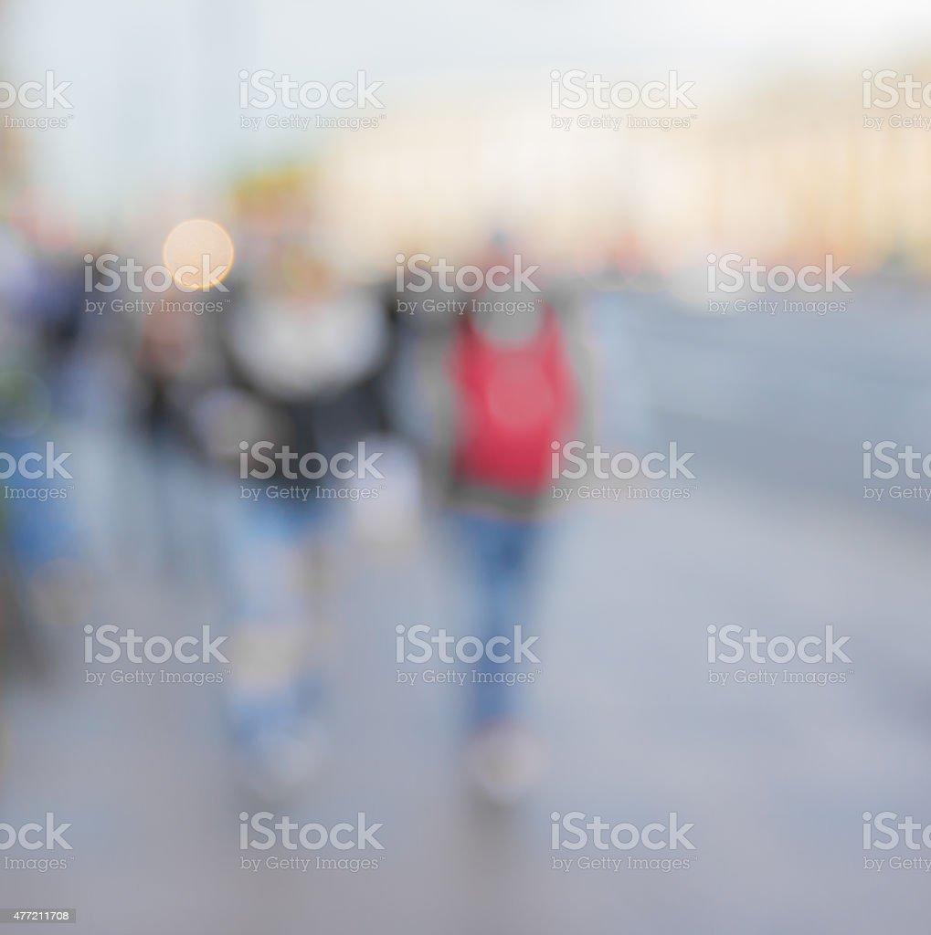 Personnes marchant sur le trottoir de flou - Photo