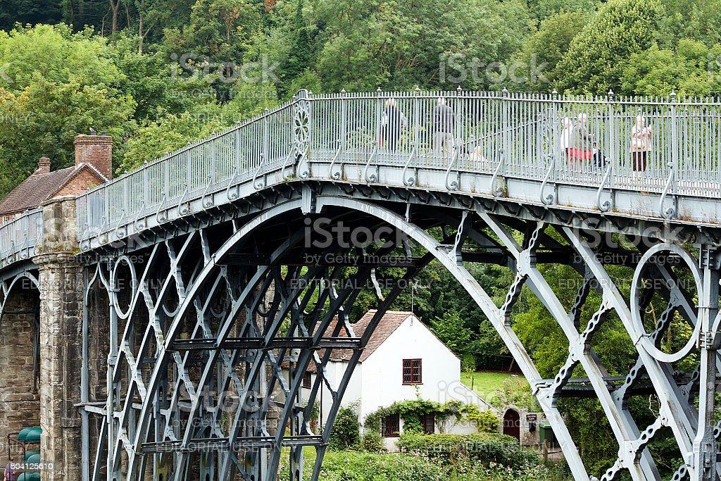 People Walking on Iron Bridge in Shropshire, England stock photo
