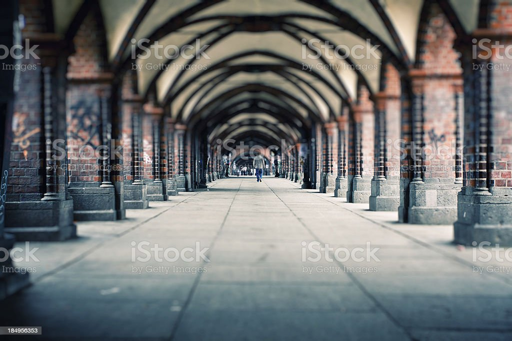 People walking on Oberbaum Bridge in Berlin, Germany stock photo
