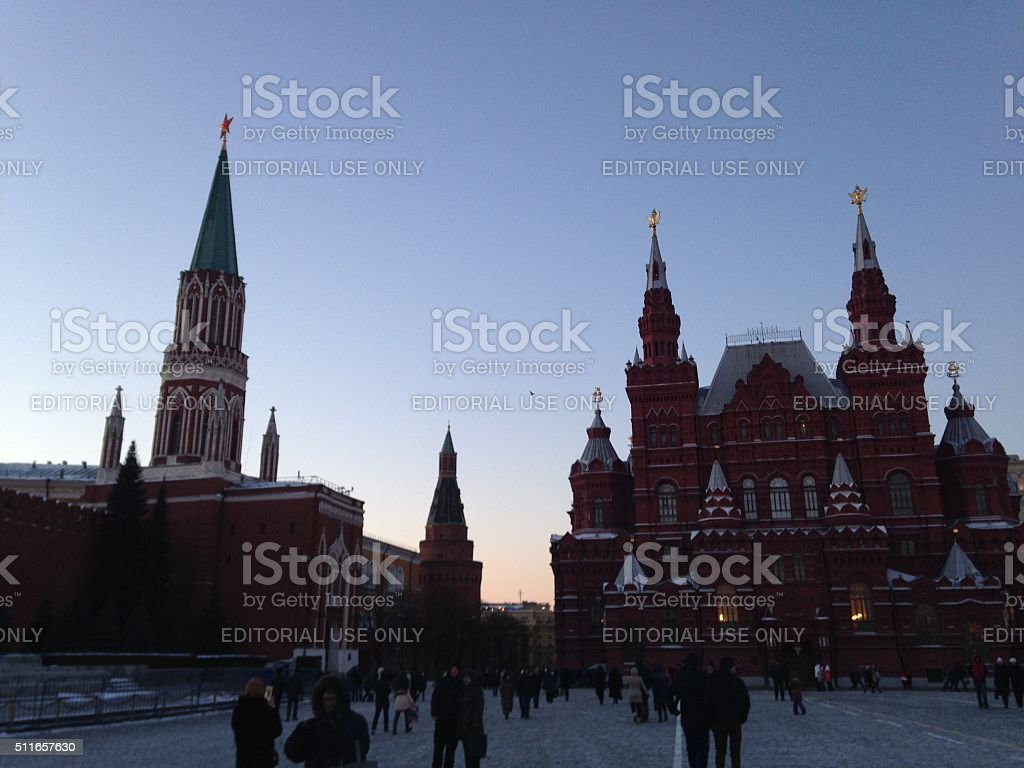 People Walking on Red Square in Winter during Sunset. stock photo