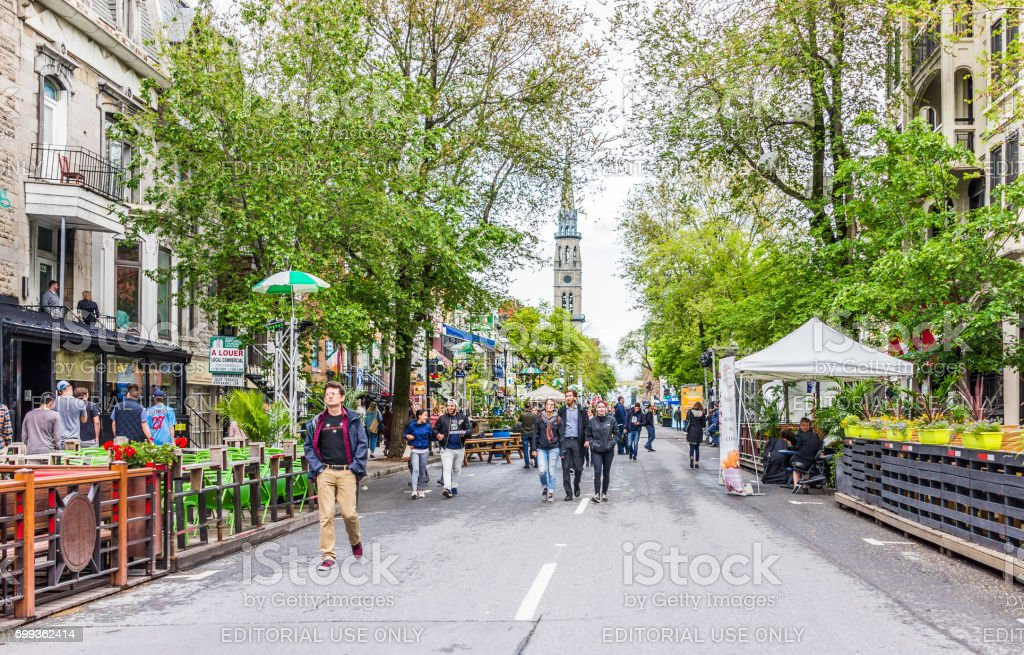People walking on Saint Denis street in Montreal's Plateau Mont Royal in Quebec region stock photo