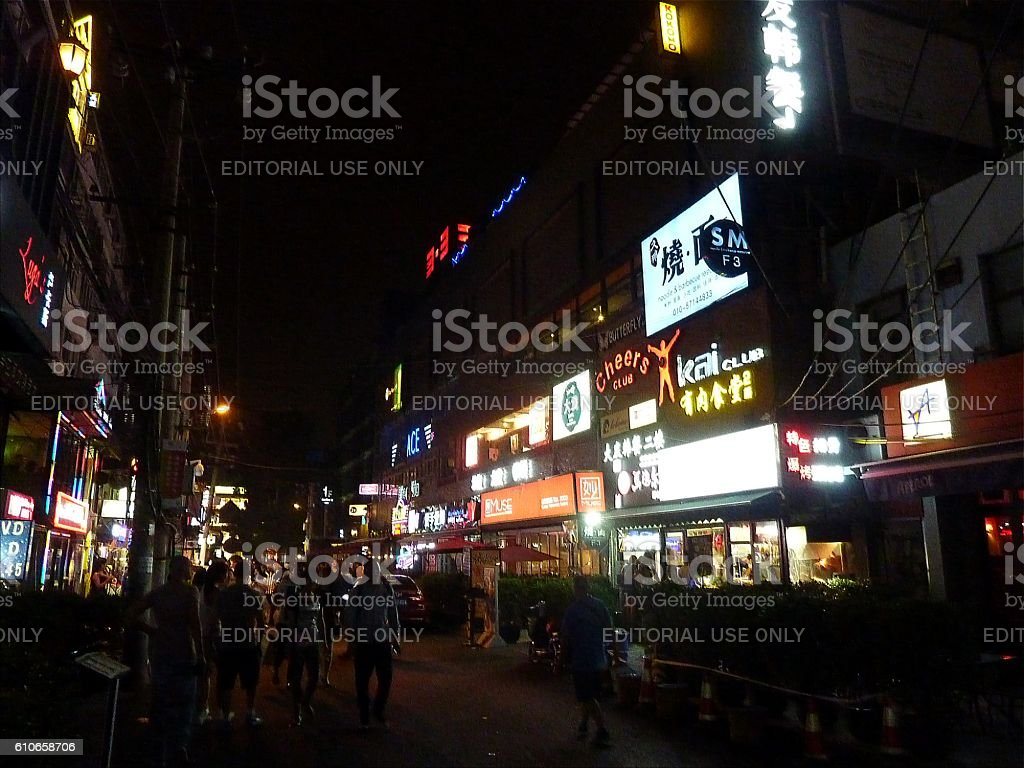 People walking on Sanlitun bar street, Beijing stock photo