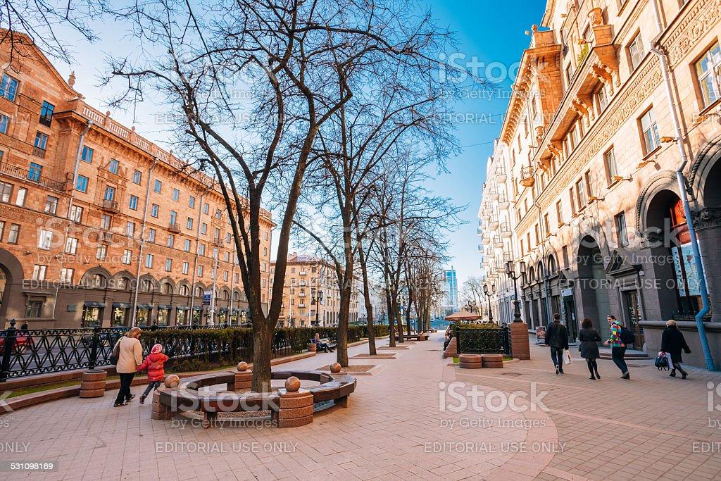 People walking on sidewalk on Lenin Street in Minsk, Belarus stock photo