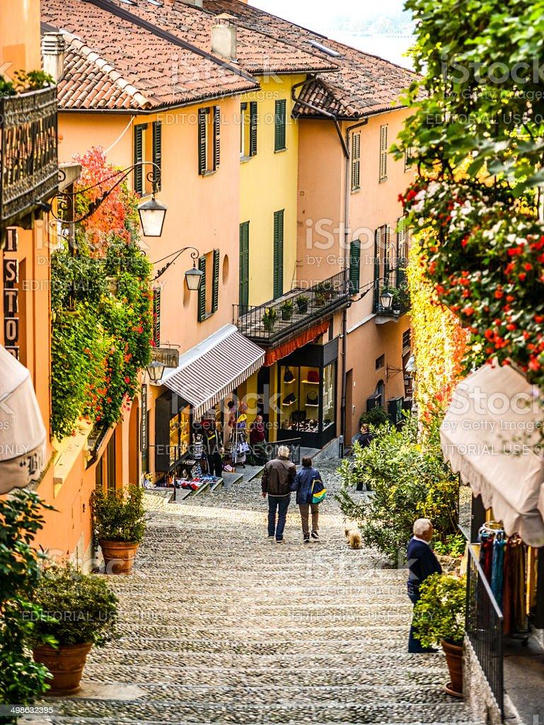 People walking on steps of Bellagio Street, Italy stock photo
