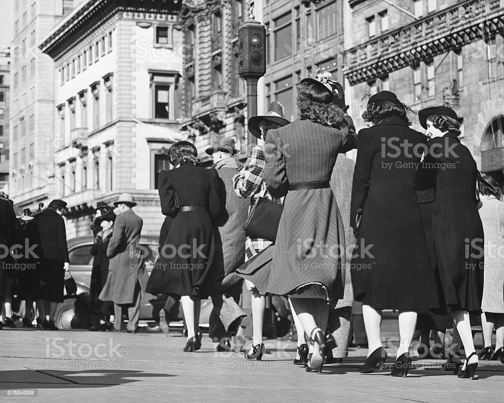 People walking on street, (Rear view), (B&W) stock photo
