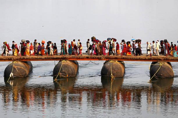 People walking on the bridge stock photo