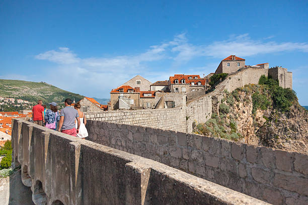 People walking on the city walls stock photo
