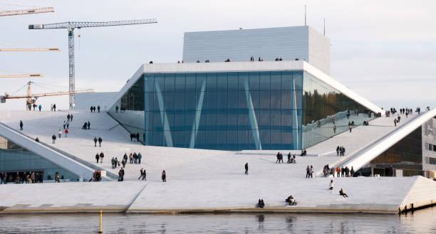 People walking on the opera house in Oslo stock photo
