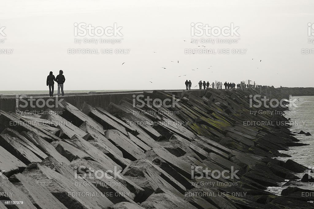 People walking on the pier of IJmuiden, North Sea stock photo