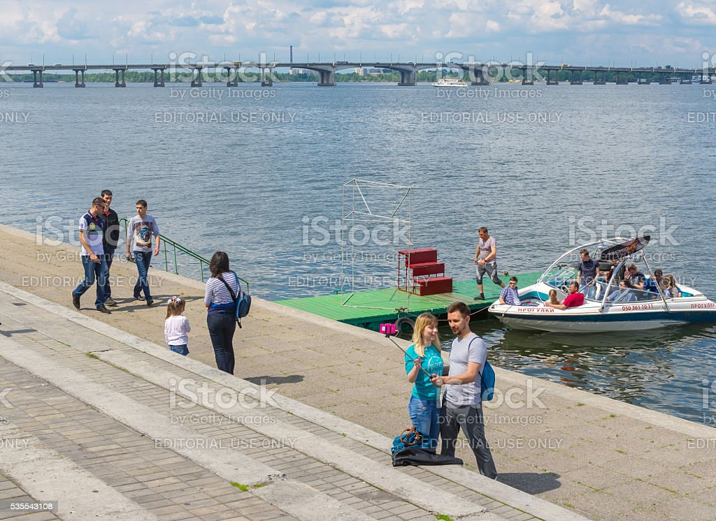 People walking on the river Dnepr embankment stock photo