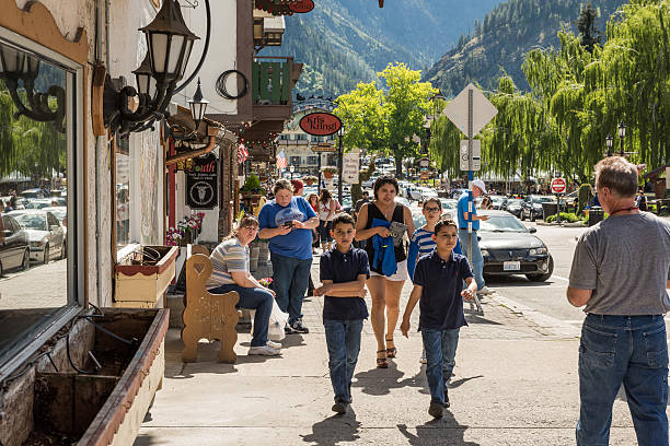 people walking on the streets of bavarian village - leavenworth washington stock photos and pictures