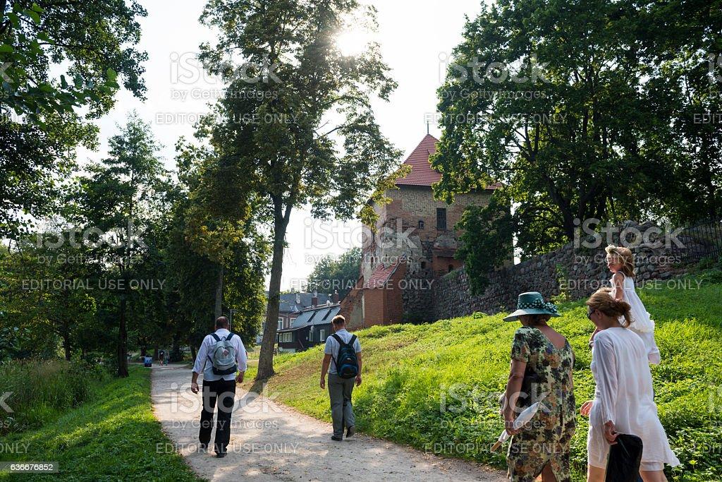 People walking on trail in Trakai, Lithuania stock photo