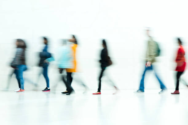 People Walking on White Background, Motion Blur stock photo