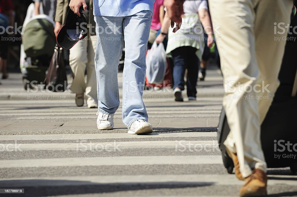 People walking on zebra crossing with bag royalty-free stock photo