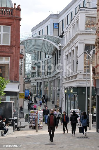 Leeds, West Yorkshire, United Kingdom - 4 September 2020: people walking outside the east entrance of the Trinity shopping centre in Leeds