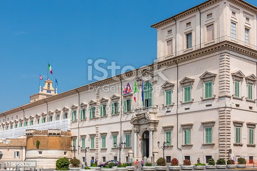 istock People walking outside the Quirinale building that holds the government authority in Rome, Italy. 1196680298