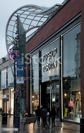 Leeds, West Yorkshire, United Kingdom - 03 December 2020: people walking outside the topshop fashion store in Briggate LeedsLeeds, West Yorkshire, United Kingdom - 22 October 2020: people walking outside the topshop fashion store in Briggate Leeds