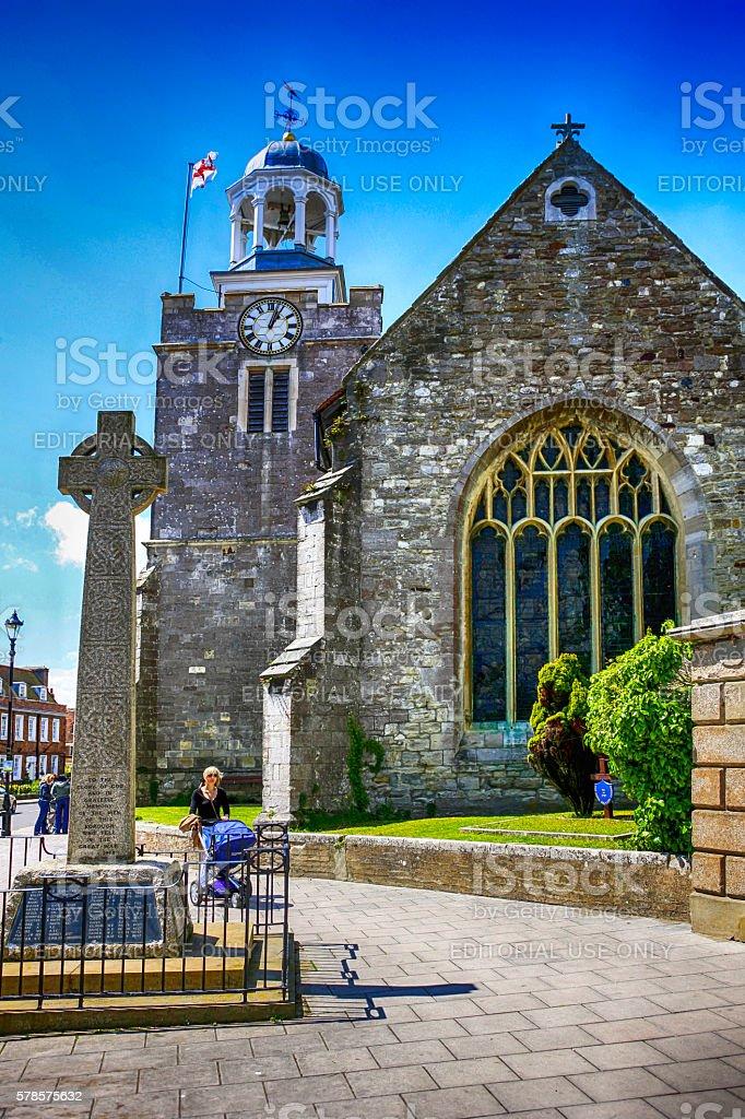 People walking past the Church of St.Thomas in Lymington, UK stock photo