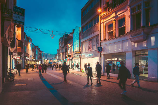 People walking, shopping around city of Oxford at night stock photo